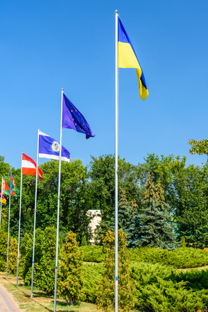 National flags of different countries in city park of Myrhorod, Ukraine Stock Photo