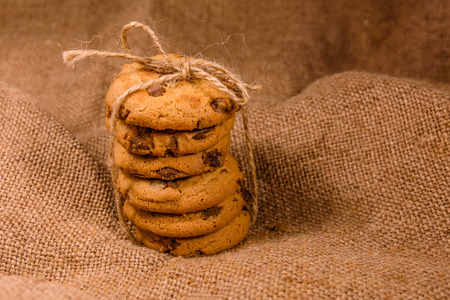 Stack of chocolate chip cookies on sackcloth Stock Photo