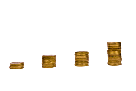 Stacks of the coins isolated on white background Stock Photo