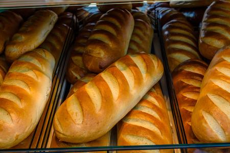 Long loafs on shelves in a supermarket