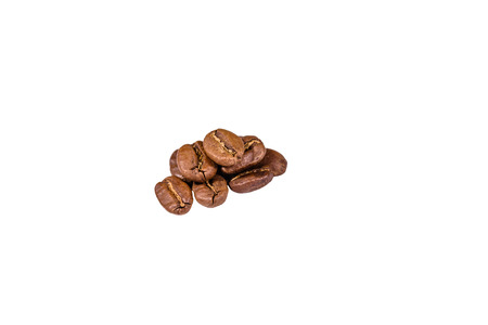 Pile of the coffee beans isolated on white background