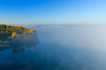 Fog over the water on river Dnieper on autumn Imagens