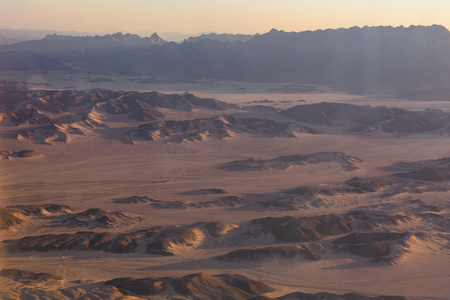 Aerial view on arabian desert and Red sea mountains from airplane