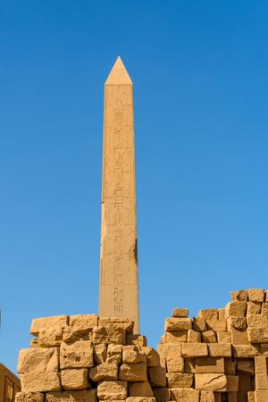 Granite obelisk against blue sky in Karnak temple. Luxor, Egypt.