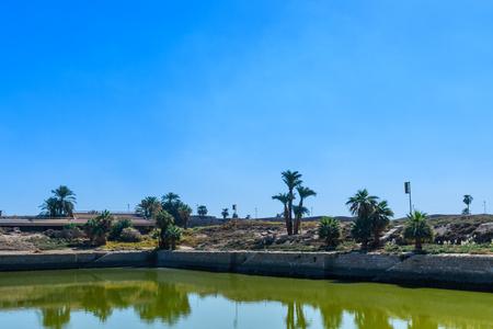 Sacred lake in ancient Karnak temple. Luxor, Egypt