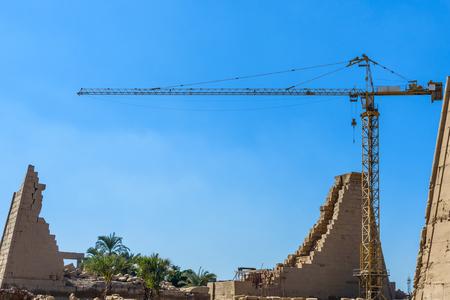 High crane on ruins of ancient Karnak temple. Luxor, Egypt Stock Photo