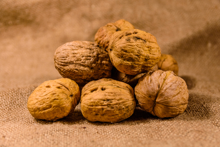 Pile of the walnuts on a sackcloth