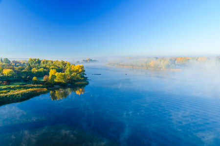 Fog over the water on river Dnieper on autumn Фото со стока - 115809141