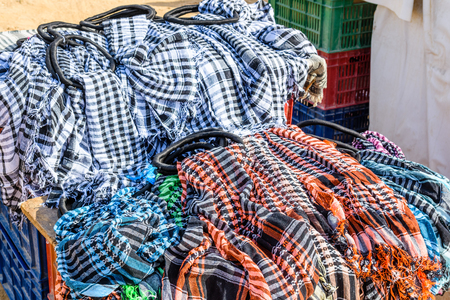 Different keffiyeh (traditional arabian headdress) for sale in street shop