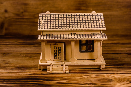 Plywood model of house on wooden table Stock Photo
