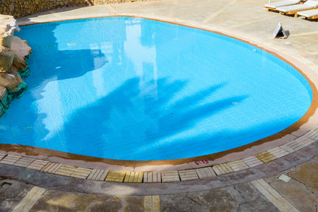 View on swimming pool with turquoise clear water