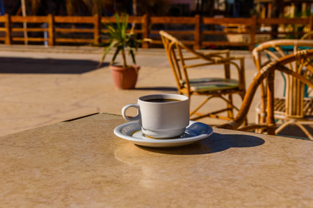 Cup of coffee on table in street cafe 版權商用圖片