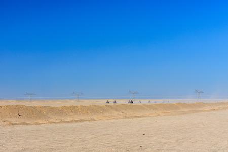 People driving quad bikes during safari trip in Arabian desert not far from Hurghada city, Egypt