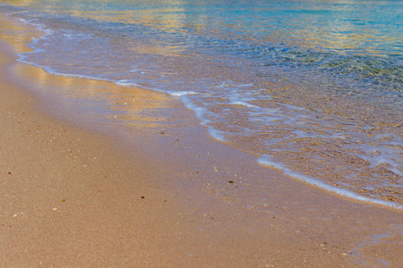 Closeup of sand on beach and Red sea water