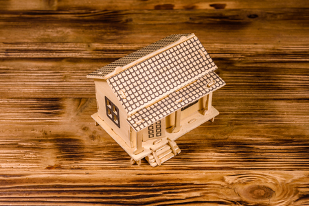 Plywood model of house on wooden table 版權商用圖片