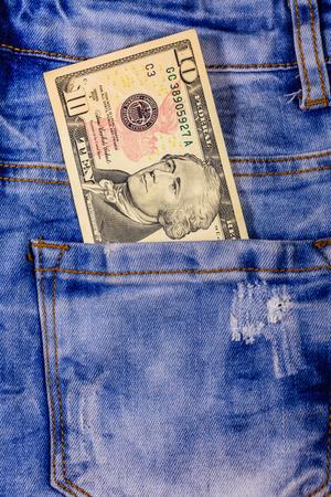 American ten dollar banknotes in pocket of blue jeans Stok Fotoğraf