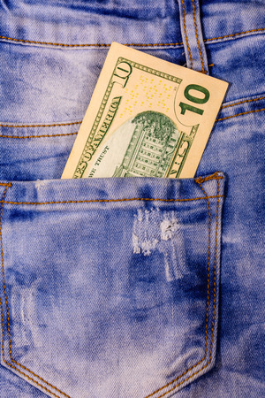 American ten dollar banknotes in pocket of blue jeans Imagens