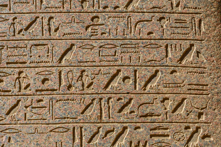 Egyptian ancient hieroglyphs on a stone wall