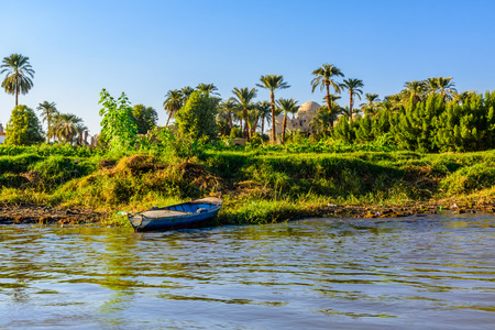 Old boat near the bank of Nile river Stock fotó