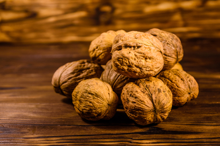 Pile of walnuts on rustic wooden table