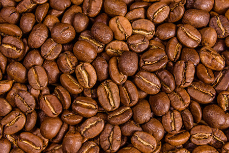Background of the many roasted coffee beans Foto de archivo - 122780503