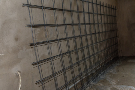 Metal grate for framework at the construction site Imagens