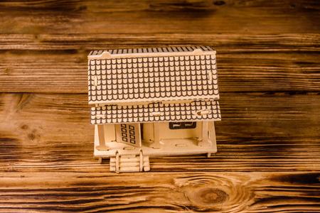 Plywood model of house on wooden table Stok Fotoğraf