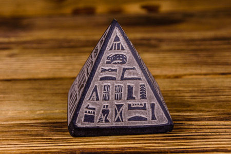 Souvenir egyptian pyramid on a wooden table