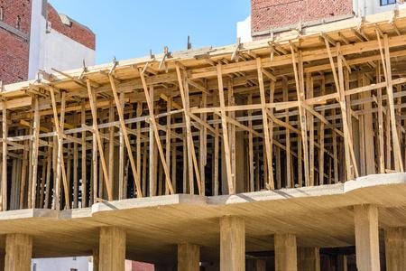 Construction of new modern residential building, wooden framework. Hurghada, Egypt