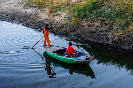 Two nubian boys in fishing boat on Nile river in Luxor, Egypt