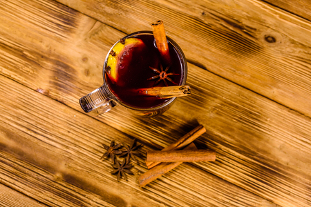 Cup of mulled wine with cinnamon on rustic wooden table. Top view Stock Photo