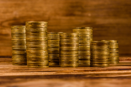 Stacks of the coins on rustic wooden table