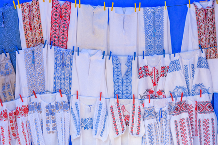 Bright ethnic shirts with traditional Ukrainian embroidery for sale on street festival