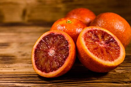Ripe sicilian oranges on rustic wooden table