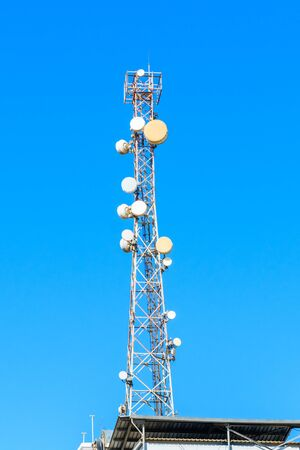 Telecommunication tower with antennas or wireless Communication antenna transmitter against blue sky