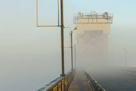 Foggy morning on bridge in Kremenchug, Ukraine Stock Photo