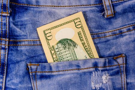 American ten dollar banknotes in pocket of blue jeans Stock Photo