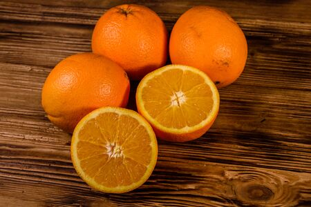 Ripe orange fruits on rustic wooden table Reklamní fotografie