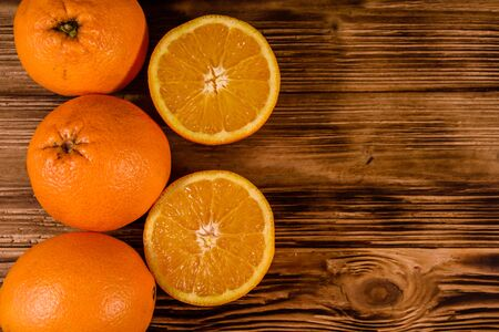 Ripe orange fruits on rustic wooden table. Top view Reklamní fotografie