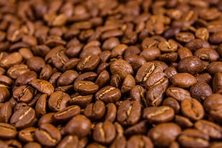Background of the many roasted coffee beans. Selective focus Archivio Fotografico