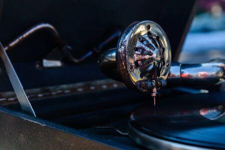Detail of old gramophone needle on vinyl disk