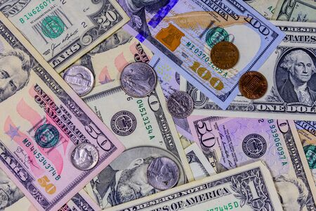 Different american cent coins over dollar banknotes Stock Photo