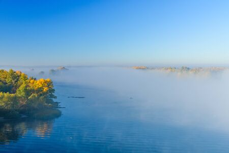 Fog over the water on river Dnieper on autumn