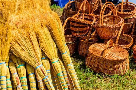 Wicker baskets and brooms for sale on street fair Stock Photo