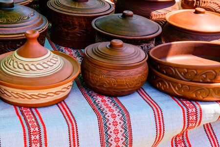 Different clay utensil for sale on country fair Stock Photo