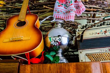 Six string classical acoustic guitar and old russian samovar