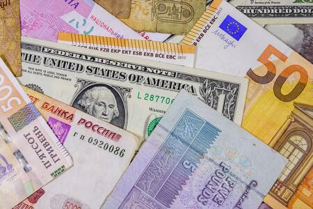 Multi currency background. Euro, american dollars, ukrainian hryvnias, egyptian pounds and russian roubles Stock Photo