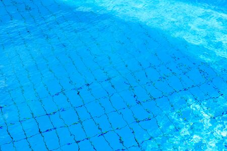 Background of turquoise water in swimming pool