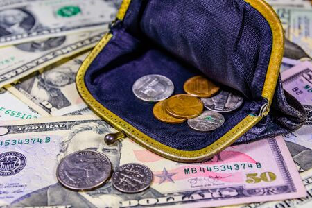 Old wallet with american cent coins over dollar banknotes Stock Photo