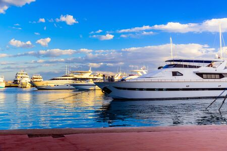 White luxury yachts in sea harbor of Hurghada, Egypt. Marina with tourist boats on Red Sea